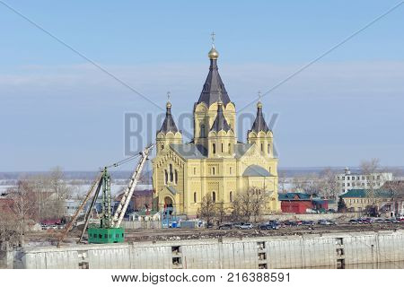 Nizhny Novgorod Russia. - March 14.2017 The Cathedral of Alexander Nevsky in the foreground the remnants of the River Port a concrete mooring berth. The highest temple of Alexander Nevsky in Russia.