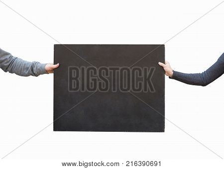 art, advertisment, pattern concept. on the white background there is small type of blackboard with negative space for text, it is held by two hands of people in warm grey sweatshits