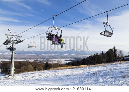 Valcianska Valley snowland. Tatras. Slovakia. 19.01.2016 . Ski resort. Chairlift with skiers on background mountains. Sunny winter day. Winter sport. Concept of leisure active healthy lifestyle winter entertainment