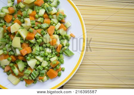 raw spaghetti with assorted garden vegetables or minestrone
