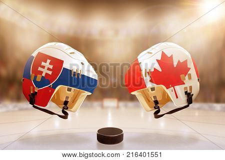 Low angle view of hockey helmets with Canada and Slovakia flags painted and hockey puck on ice in brightly lit stadium background. Concept of intense rivalry between the two hockey nations.