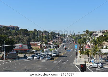 DANA POINT, CA - DEC 1, 2017: Pacific Coast Highway seen from the pedestrian bridge looking north up the coast road.