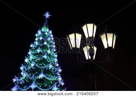 decorated with baubles and garlands Christmas tree and city ligh