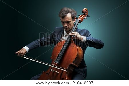 Lonely cellist composing on cello with nothing around