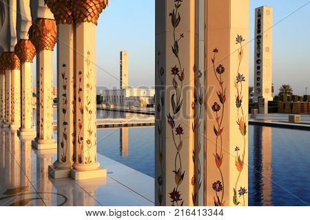 Abu Dhabi, UAE - November 05, 2017: Columns of Sheikh Zayed Mosque in evening sunlight. Exterior of Sheikh Zayed Mosque