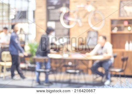 Blurred background : blur group of people team meeting at co-working space casual style teamwork concept business education concept