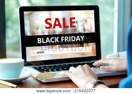Woman hands typing laptop computer with www. on search bar over black friday sale banner background Holiday shopping online business and technology