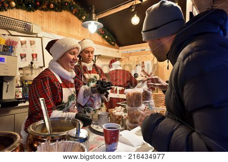 VILNIUS LITHUANIA - DECEMBER 02: Unidentified people trade food in annual traditional Christmas fair on December 02 2017 in Vilnius Lithuania.