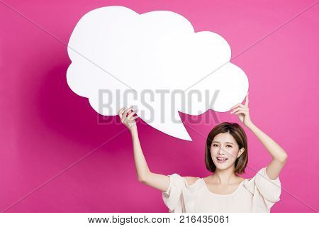 happy young asian woman showing dialog signs