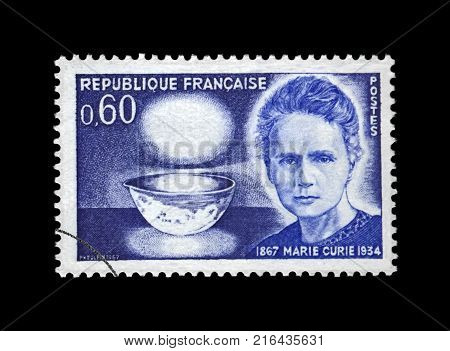 FRANCE - CIRCA 1967: canceled stamp printed in France shows famous polish nobel prize winner in 1903, 1911 - phisicist Marie Sklodowska-Curie (1867-1934), bowl glowing with radium, circa 1967.