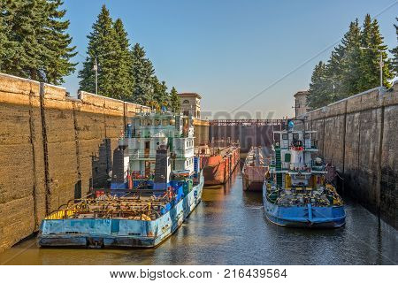 Barge tug in gateway on Moscow Canal