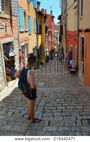ROVINJ,  ISTRA, CROATIA -  JUNE  20, 2017:  The Steep streets of Rovinj old town with tourists and shops  Croatia.