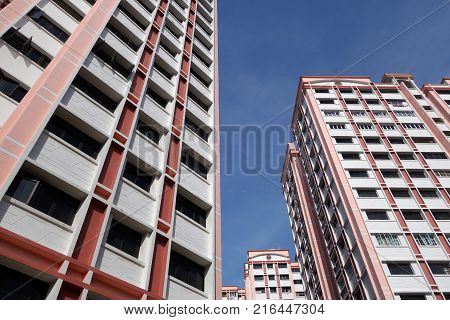 Block of HDB Flats found in Singapore against blue sky