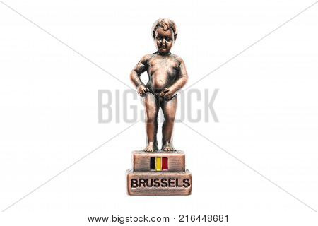 Belgium souvenir refrigerator magnet pissing boy from Brussels isolated on white. Refrigerator magnets are popular souvenirs.