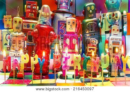 Happy Bithday candels and vintage robot toys