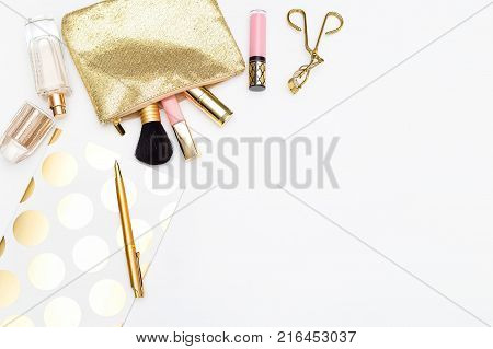 Female workplace with make-up cosmetics on a white background. Copyb space