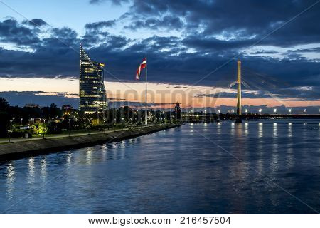 Riga .Latvia.7 September 2017.View of the cable-stayed bridge and the embankment of the river Daugava in Riga at sunset.
