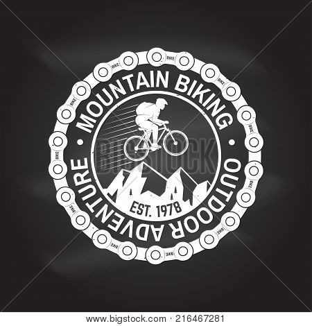 Mountain biking. Vector illustration. Concept for shirt or logo, print, stamp or tee. Vintage typography design with man riding bike, chain and mountain silhouette. Chalk drawing on a blackboard.