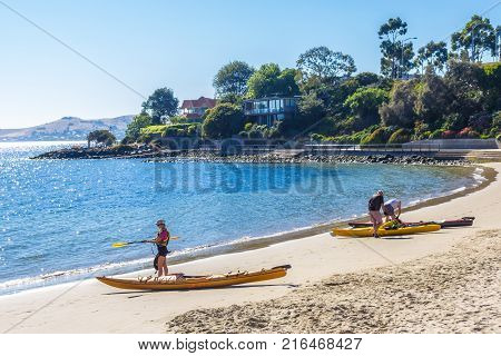 Sandy Bay Hobart Australia - 7 January 2017: sea kayakers about to go for a paddle