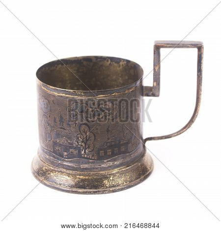 Old silver glass-holder with depicted landscape. Isolated on white background