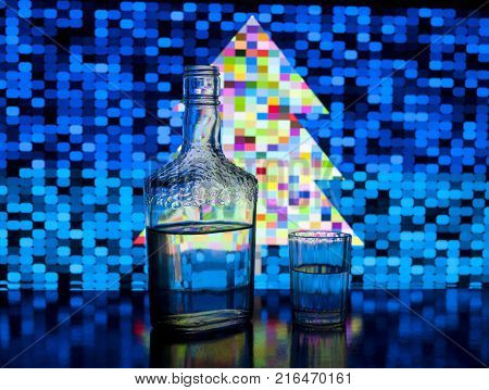 Glass bottle of vodka and a cup with vodka on a background pixel Christmas tree