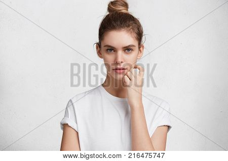 Photo Of Surprised Shocked Woman Keeps Mouth Widely Opened, Looks With Dissatisfied Expression As Fi