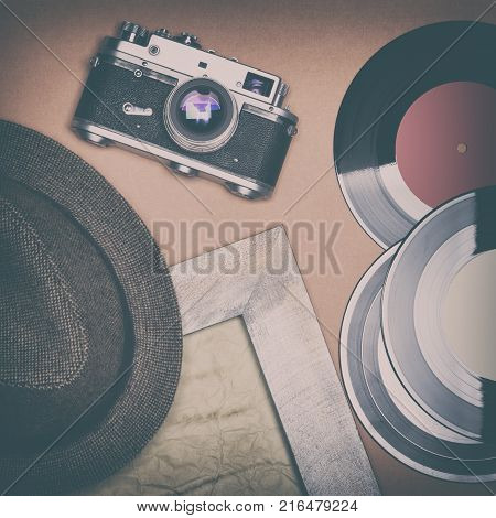 Retro things set. Vintage film camera, old vinyl records, shabby wooden frame, aged paper, trilby hat. Nostalgic mood concept
