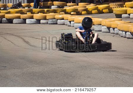 A Child Riding On The Map On The Kart Track.