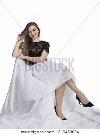 Girl In White Skirt Posing Sitting .