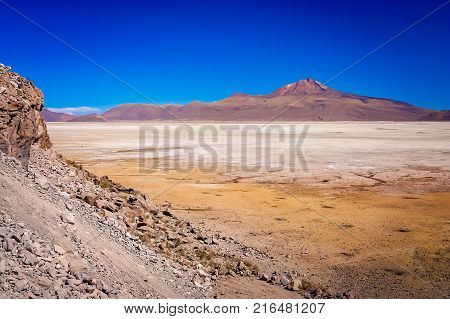 Dry land plain in the Altiplano mountains near Salar de Uyuni in summer, Andes, Bolivia
