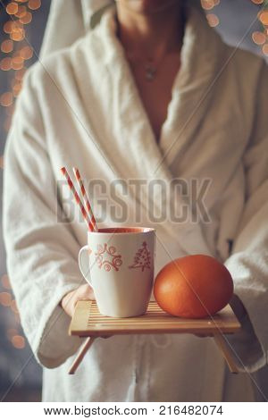 Girl holding a tray of coffee and fruit . Christmas holiday concept. Holiday background