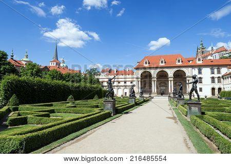 Statues along an alley and Sala Terrena (Garden Pavilion) at the Wallenstein (Waldstein) Garden (Valdstejnska Zahrada)). It is a public Baroque garden at the Lesser Town (Mala Strana) in Prague, Czech Republic.