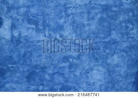 Grunge blue faded uneven old aged daub plaster wall texture background with stains and paint strokes, close up poster