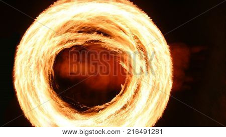 Fire poi show in the dark - fire rounds in speed