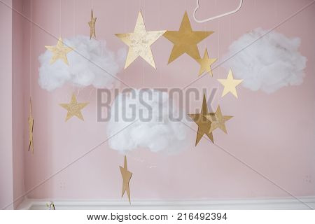 Picture of pretty stars and clouds hanging decoration for kids.