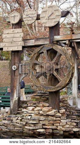 Large rustic old wooden clock and calendar