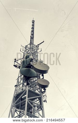 Low-angle Vintage Shot Transmitters And Aerials On Telecommunication Tower