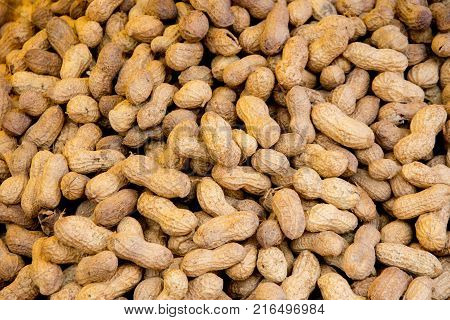 closeup shoot of plie of the unpeeled healthy peanuts