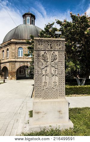 Building of the Gevorgyan Spiritual Academy with the ancient khachkar in the park in Etchmiadzin