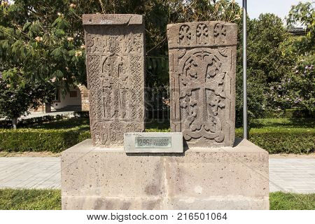 Stone cross in Echmiadzin (Vagharshapat) made of red stone tufa christian artArmenia Caucasus unesco world heritage site