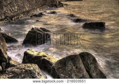waves over rocks at sunset on the bay of biscay beach spain
