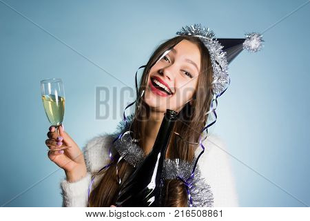funny drunken young girl celebrates the new year 2018, drank a lot of champagne