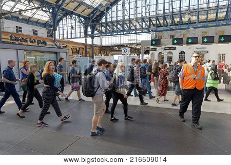 BRIGHTON GREAT BRITAIN - JUN 19 2017: People walking in a hurry in the train station in Brighton UK. June 27 2017 in Brighton Great Britain