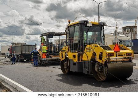 Road Rollers Compressing Sand To Highway