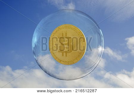 Bitcoin inside a bubble and a sky clouds background. Rise and fragility concept