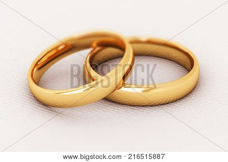 3D render illustration of the macro view of pair of shiny golden wedding rings isolated on white background with selective focus effect