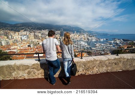 MONACO - March 17 : Couple tourists at panoramic view of Port de Fontvieille from Prince's Palace on Monaco Monaco city in Monaco on March 17 2017.