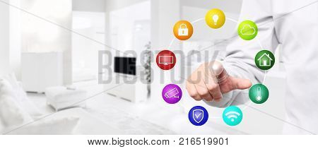 smart home automation hand touch screen with colored symbols on interior room background web banner and copy space template