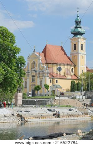 Carmelite Church Next to the Raba River Bank in Gyor City