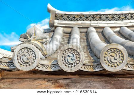 Ornate design in traditional Japanese architecture  Ornate design end pieces of Roof Tiles in traditional Japanese and Chinese Architectures. They are for protective and decorative purposes, also known as 'WADANG' in Japan